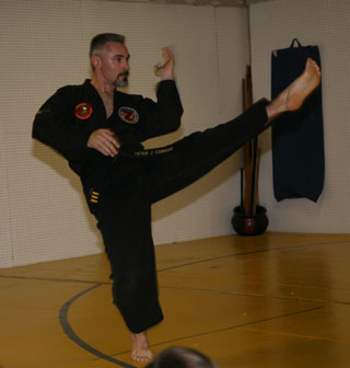 Master Pete executing a sliding twist front kick (note the goatee!)
